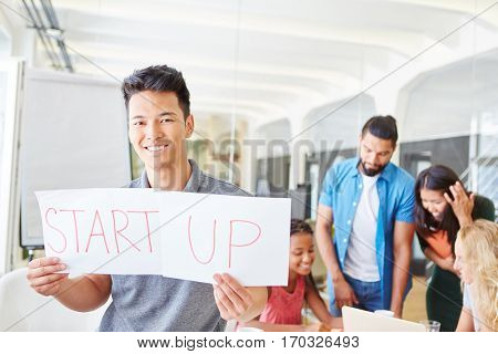Start-up founder with team in conference room