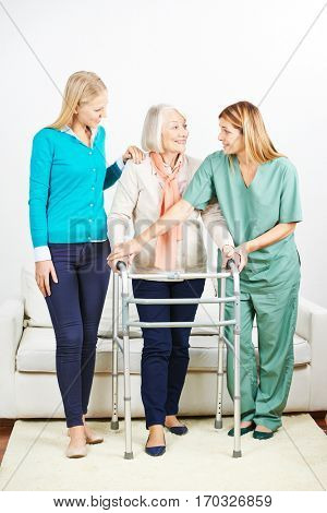 Nurse helping senior woman with walker at home