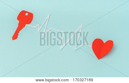 Paper cut of Key for heart as a symbol of love