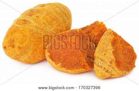 Close up of Pieces of turmeric over white background