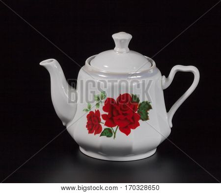 Cup of tea on a black background, white porcelain