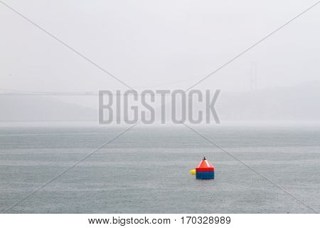 A buoy in bosphorus in a rainy day