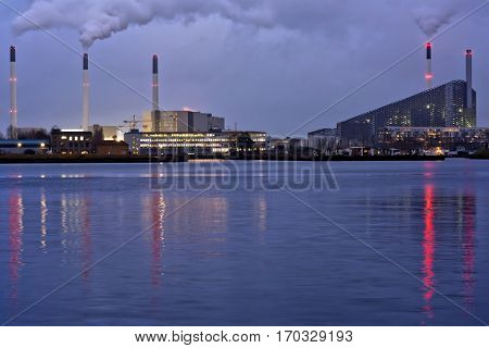 COPENHAGEN, DENMARK - DECEMBER 28, 2016: Night view to the industrial district. Power plant of HOFOR is visible on the left, and right side is the incinerator Amager Bakke which must be opened in 2017