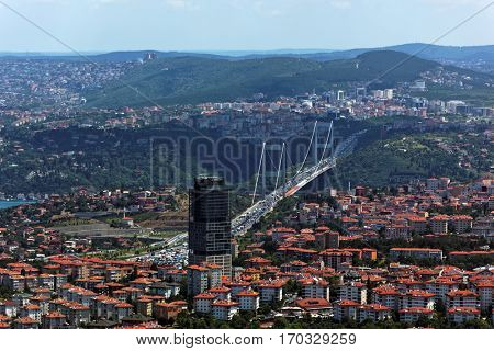 ISTANBUL, TURKEY - JUNE 30, 2012: Cityscape with Le Meridien Istanbul Etiler hotel and Fatih Sultan Mehmet Bridge. Completed in 1988, is was the second bridge across Bosporus strait