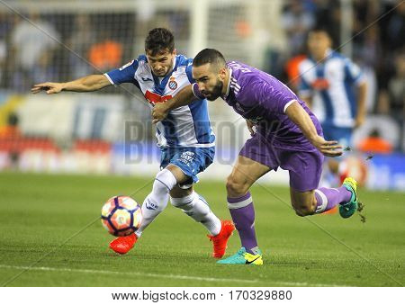 BARCELONA, SPAIN - SEPT, 18: Pablo Piatti(L) of RCD Espanyol and Dani Carvajal(R) of Real Madrid fight during a Spanish League match at the RCDE Stadium on September 18 2016 in Barcelona Spain