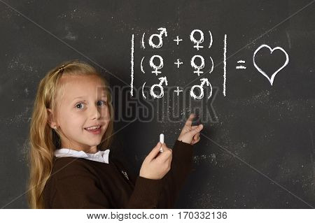 young beautiful blond sweet schoolgirl in uniform holding chalk writing on blackboard standing for freedom of sexuality orientation supporting love for heterosexual and homosexual couples