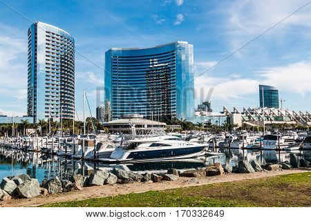 SAN DIEGO, CALIFORNIA - JANUARY 8, 2017:  Yachts in harbor at Embarcadero Marina Park North with hotels and convention center.