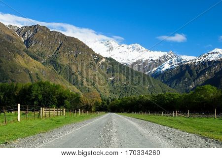 A Long Gravel Road Stretched Towards The Alps.  Mt Aspiring National Park, Southern Alps, New Zealand