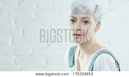 Portrait of platinum blonde young woman with innocent look.