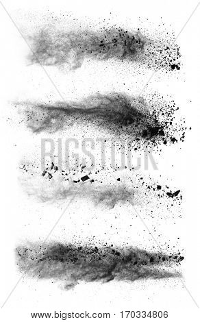 Freeze motion of black dust explosions isolated on white background