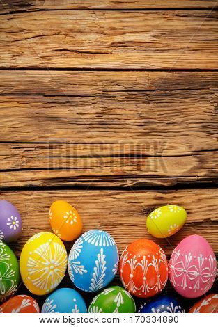 Easter eggs placed on wooden board, easter holiday concept. Copyspace for text.