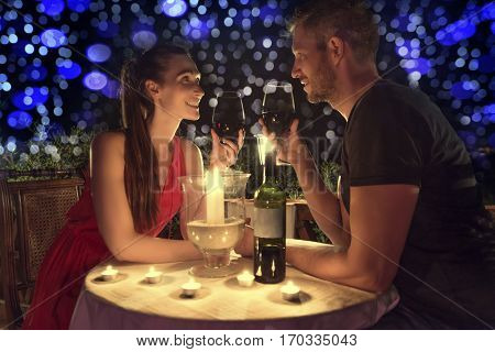 candlelight dining couple in love