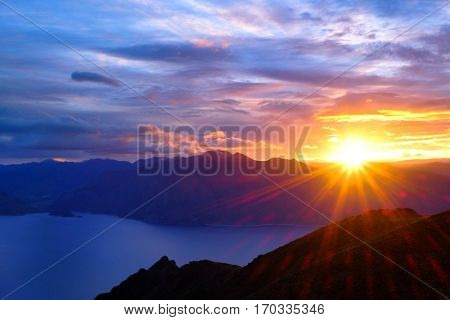 A Colorful Sunrise Over Lake Hawea from Isthmus Peak.  Southern Alps, New Zealand