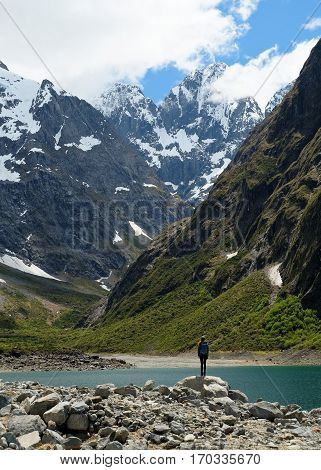 A Woman Hiker On a Lake Shore in The Southern Alps  Lake Marian, Fjordland National Park, New Zealand