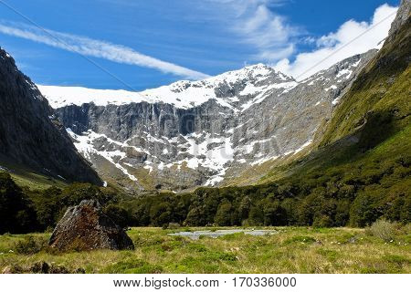 A Glacier Canyon and Snowy Peak.  Milford Sound, Fjordland National Park, New Zealand