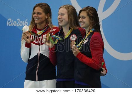 RIO DE JANEIRO, BRAZIL - AUGUST 8, 2016: Yulia Efimova of Russia (L), Lilly King and Catherine Meili of USA during medal ceremony after Women's 100m Breaststroke Final of the Rio 2016 Olympic Games