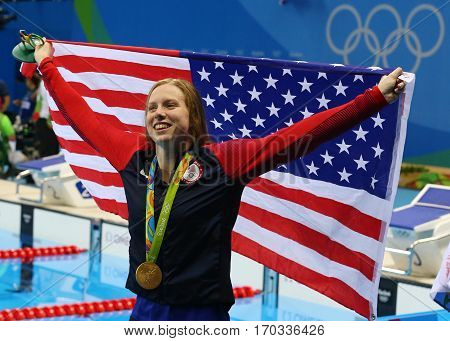 RIO DE JANEIRO, BRAZIL - AUGUST 8, 2016: Olympic Champion swimmer Lilly King of the United States celebrates victory after Women's 100m Breaststroke Final of the Rio 2016 Olympic Games
