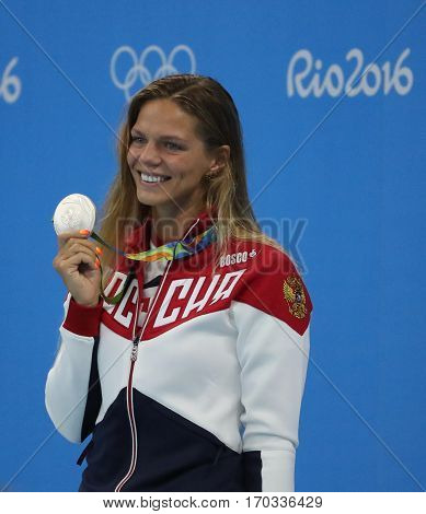 RIO DE JANEIRO, BRAZIL - AUGUST 8, 2016: Silver medalist swimmer Yulia Efimova of Russia during medal ceremony after Women's 100m Breaststroke Final of the Rio 2016 Olympic Games at Aquatics Stadium