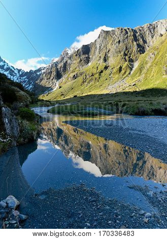 Mountain Reflections in Young Basin.  Aspiring National Park, Southern Alps, New Zealand.