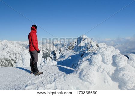 A Hiker on the Summit of Mt Ellinor in Winter.  Olympic National Park, Washington.