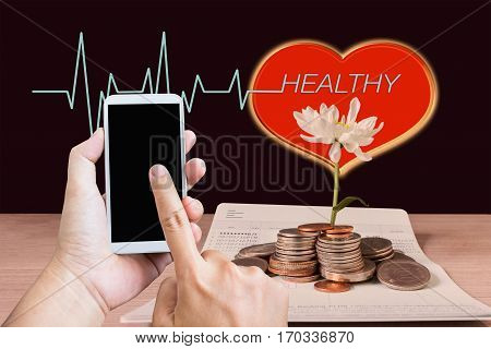 Women Hand Holding Cellphone Or Smartphone Or Mobile Phone With Money Saving Concept Background