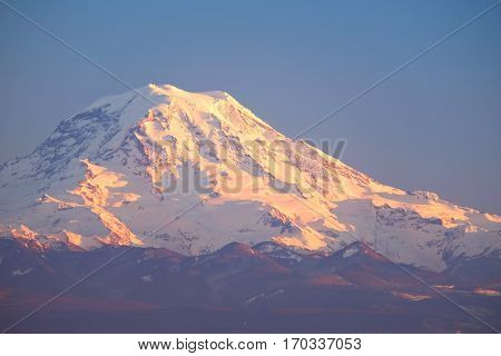 Sunset Illuminates Mt Rainier. Cascade Mountains Washington