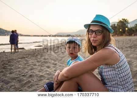Mother and son at Alanya beach, view from the beach, one of the famous destinations in Turkey.