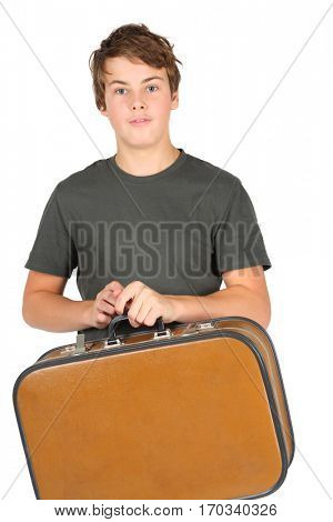 Boy teenager in grey t-shirt holds suitcase isolated on white background