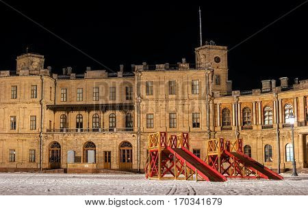 Gatchina Palace. The main entrance to the palace. Night Photography. In the foreground - wooden roller coaster to ride. Russia.