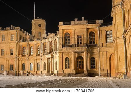 Gatchina Palace. Entrance to the right wing. Night Photography. At the clock tower is installed a flagpole for the imperial flag. Russia.