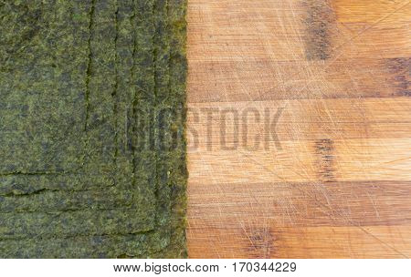Nori Seaweed Sheets On Old Wooden Background