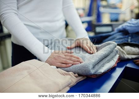 Working in dry-cleaning shop