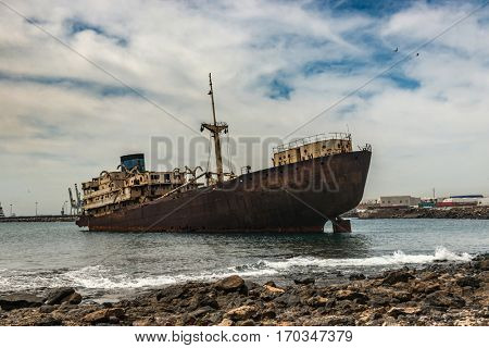 Old rusty industrial Spanish ship, floating ashore as a tourist attraction, Lanzarote