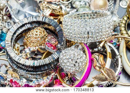 Many fashionable women's jewelry. Brilliant the bangles