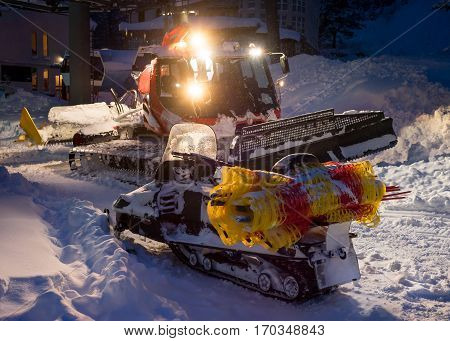 Snowcat Preparing A Slope In Mountains