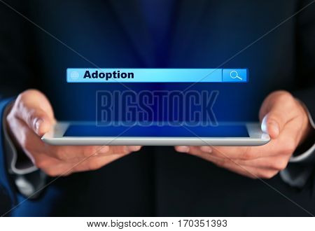 Adoption concept. Male hands with tablet and search box