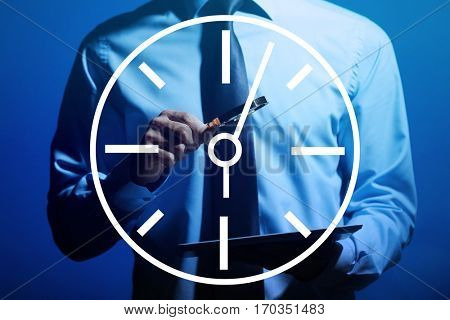 Time concept. Business man holding tablet and magnifier