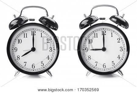 Time change concept. Alarm clocks on white background