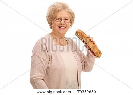 Cheerful elderly woman having a sandwich isolated on white background
