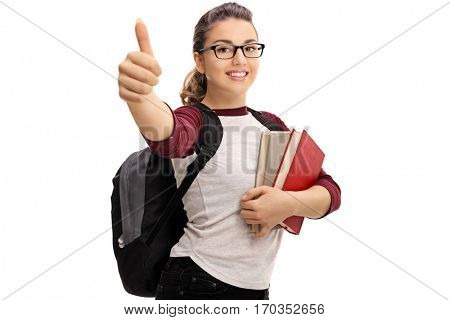 Female student making a thumb up sign isolated on white background