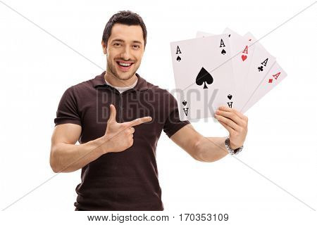 Happy guy holding four aces and pointing isolated on white background
