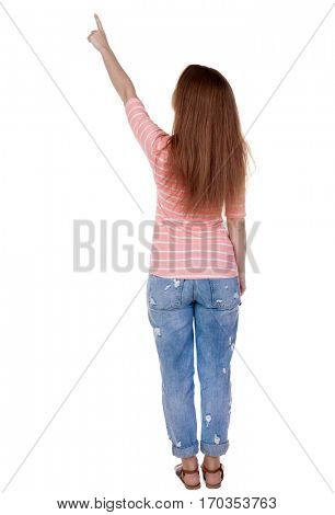 Back view of  pointing woman. beautiful redhaired  girl . girl shows something to someone. Rear view people collection.  backside view of person.