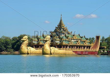 YANGON, MYANMAR - DECEMBER 18, 2016: View of the royal Karawait barge on the Kandawgyi lake in downtown Yangon. Myanmar