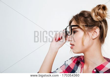 Side view of Model in shirt and eyeglasses looking aside. Close up. Isolated gray background