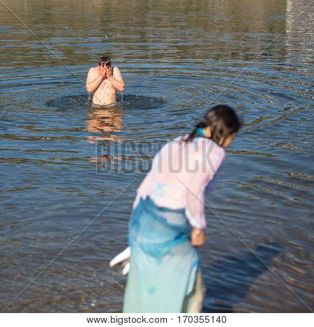PORTO, PORTUGAL - JAN 19, 2017: Celebrating Baptism of Jesus and Epiphany bathing in Douro river in the Parish of Russian Orthodox Church. This is one of the holiest holidays for all Christians.