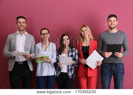 Group of people waiting for job interview and standing on colour background