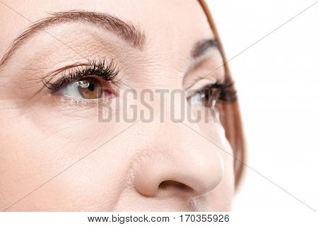 Close up view of senior woman's face on white background