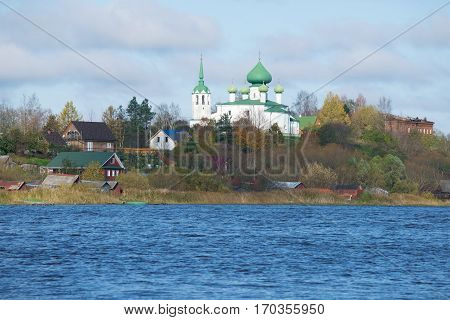Church of the Nativity of John the Baptist from the Volkhov river cloud October day. Staraya Ladoga, Russia