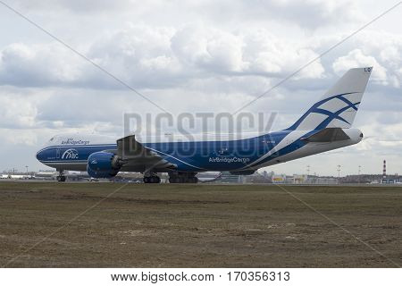 MOSCOW, RUSSIA - APRIL 15, 2015: Boeing 747-8 ( onboard VQ-BLQ) airlines Air Bridge Cargo on the taxiway at the airport Sheremetyevo