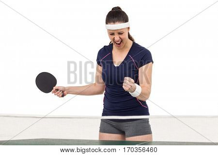 Female table tennis player posing after victory on white background